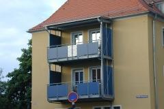 Balkon blaue Fassade